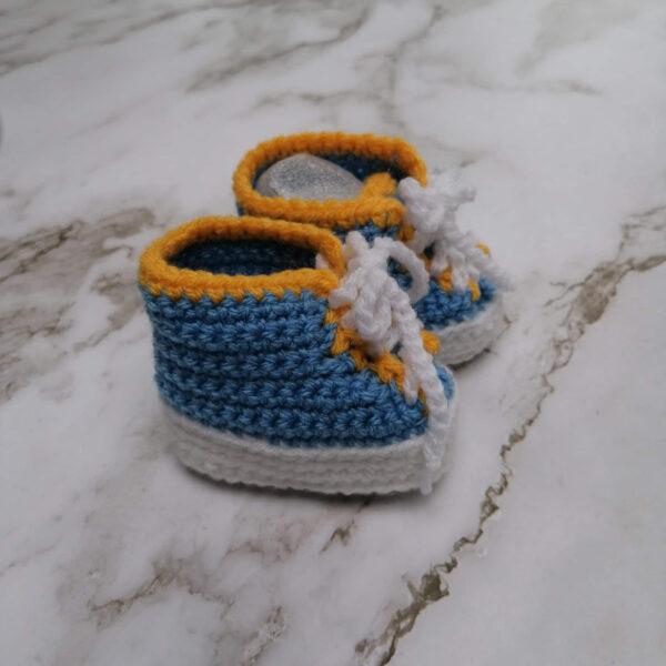 Baby gympie schoen blauw geel zij