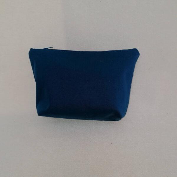 Toilettas vuurtoren blauw achter